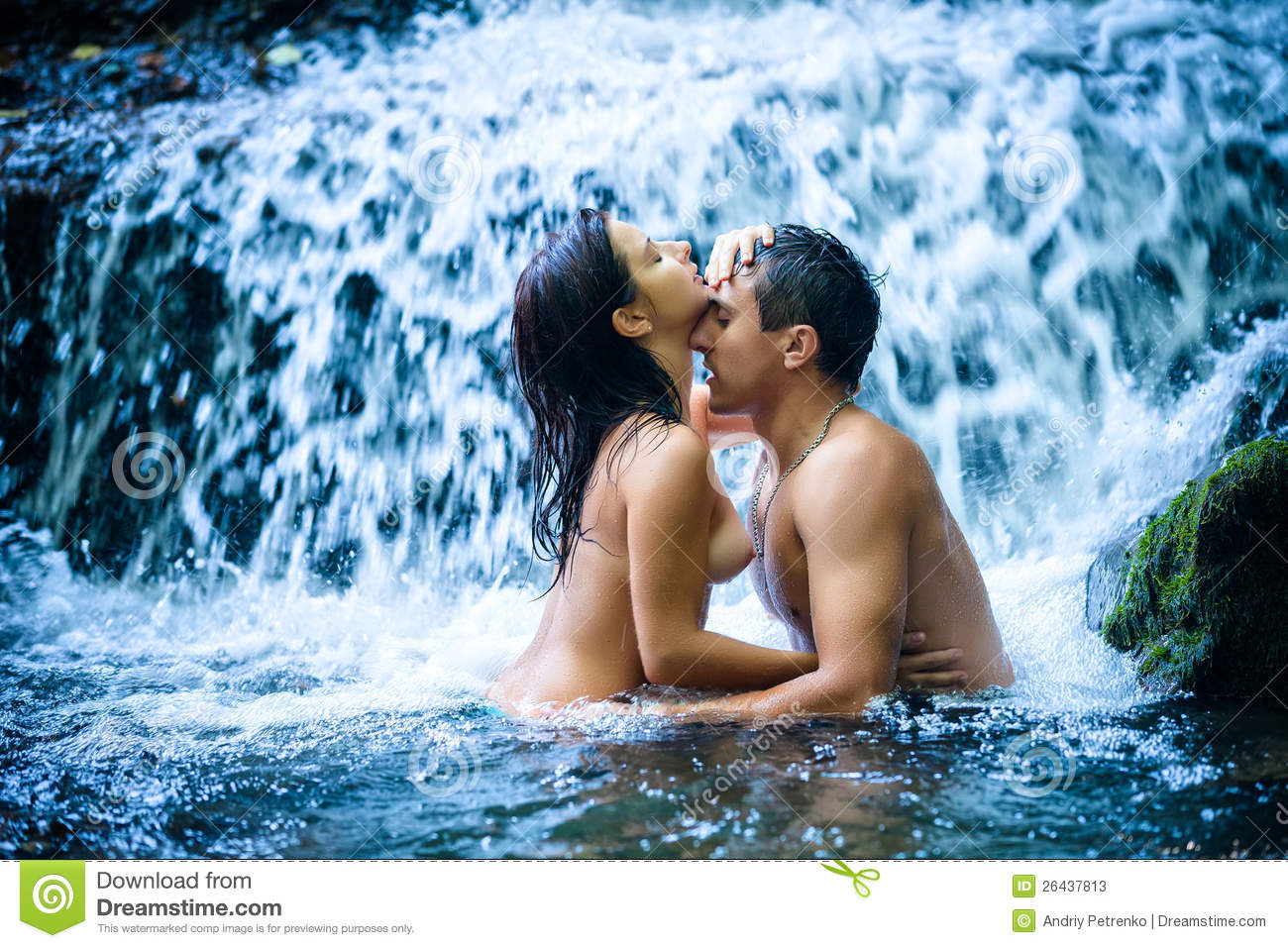 Naked couple kissing in water