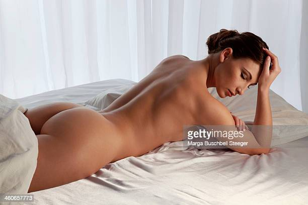Nude woman on stomach