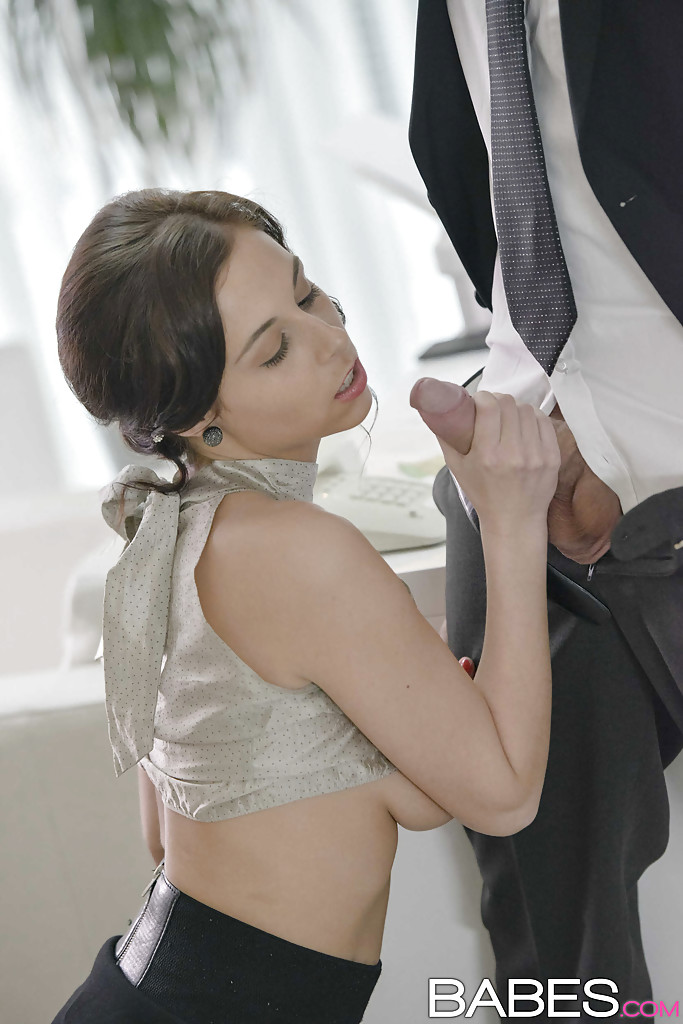 Woman on knees giving oral sex